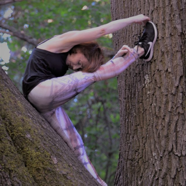 Ahna practicing yoga in a tree